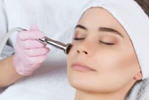 Woman receiving microdermabrasion
